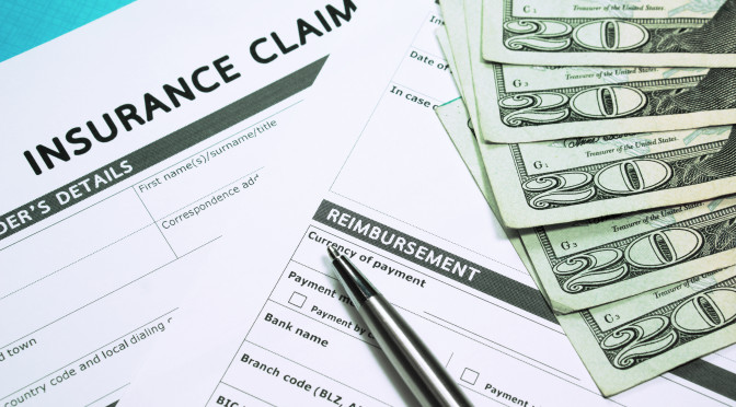 Insurance Concept With Claim Form And Money